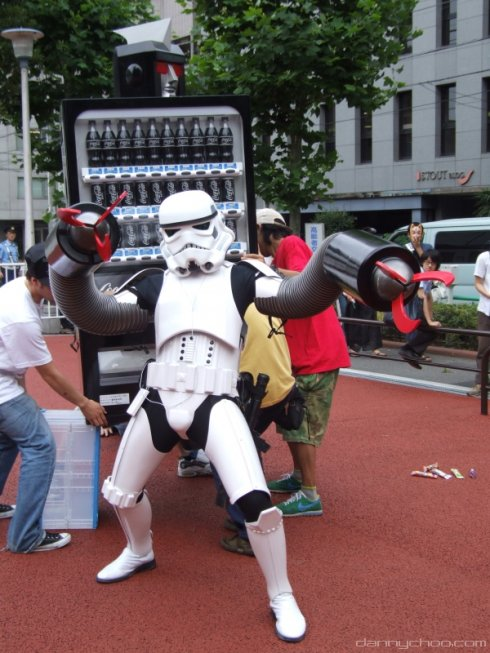 Anime Look-Alike : Danny Choo clad in a Stormtrooper costume terrorizing the demonstrators with his new found attachments.